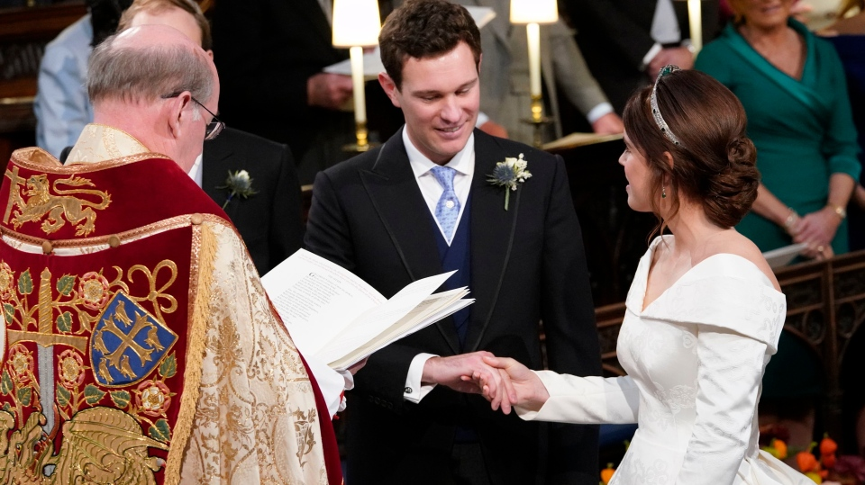 Princess Eugenie and Jack Brooksbank during their wedding ceremony in St George's Chapel, Windsor Castle, near London, England, Friday Oct. 12, 2018. (Danny Lawson/Pool via AP)