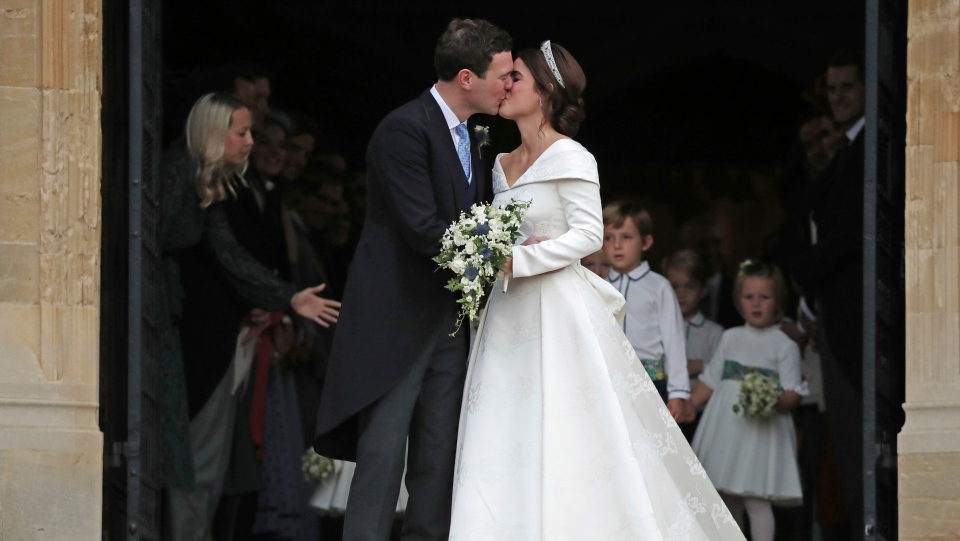 Princess Eugenie of York and Jack Brooksbank kiss after their wedding ceremony at St George's Chapel, Windsor Castle, near London, England, Friday Oct. 12, 2018. (Steve Parsons, Pool via AP)