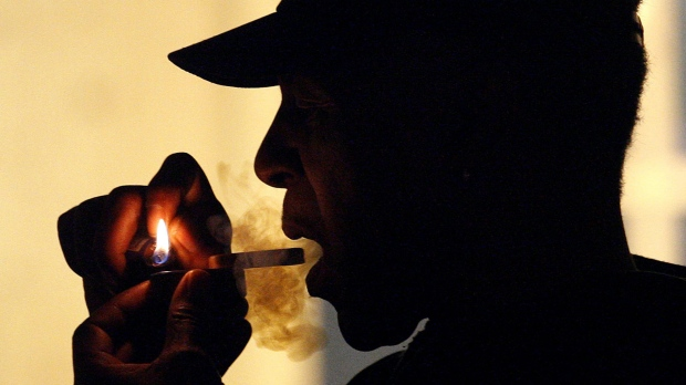 In this May 5, 2011, file photo an unidentified man smokes medical marijuana during karaoke night at the Cannabis Cafe, in Portland, Ore. (AP Photo/Rick Bowmer, File)