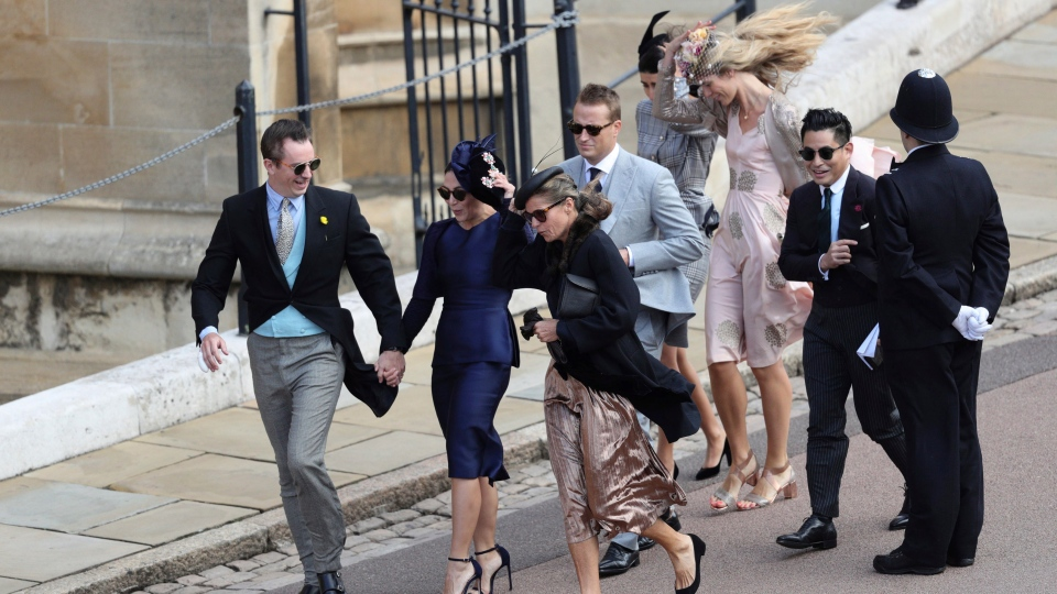 Guests arrive for the wedding of Princess Eugenie of York and Jack Brooksbank at St George's Chapel, Windsor Castle, near London, England, Friday Oct. 12, 2018. (Aaron Chown/Pool via AP)