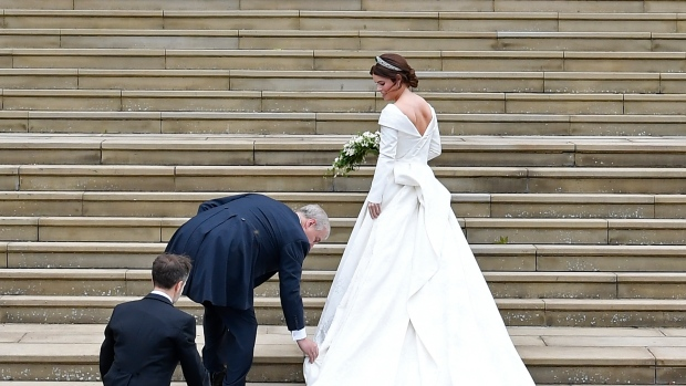 Princess Eugenie arrives accompanied by her father Prince Andrew at St George's Chapel for her wedding to Jack Brooksbank in Windsor Castle, near London, England, Friday Oct. 12, 2018. (Toby Melville, Pool via AP)