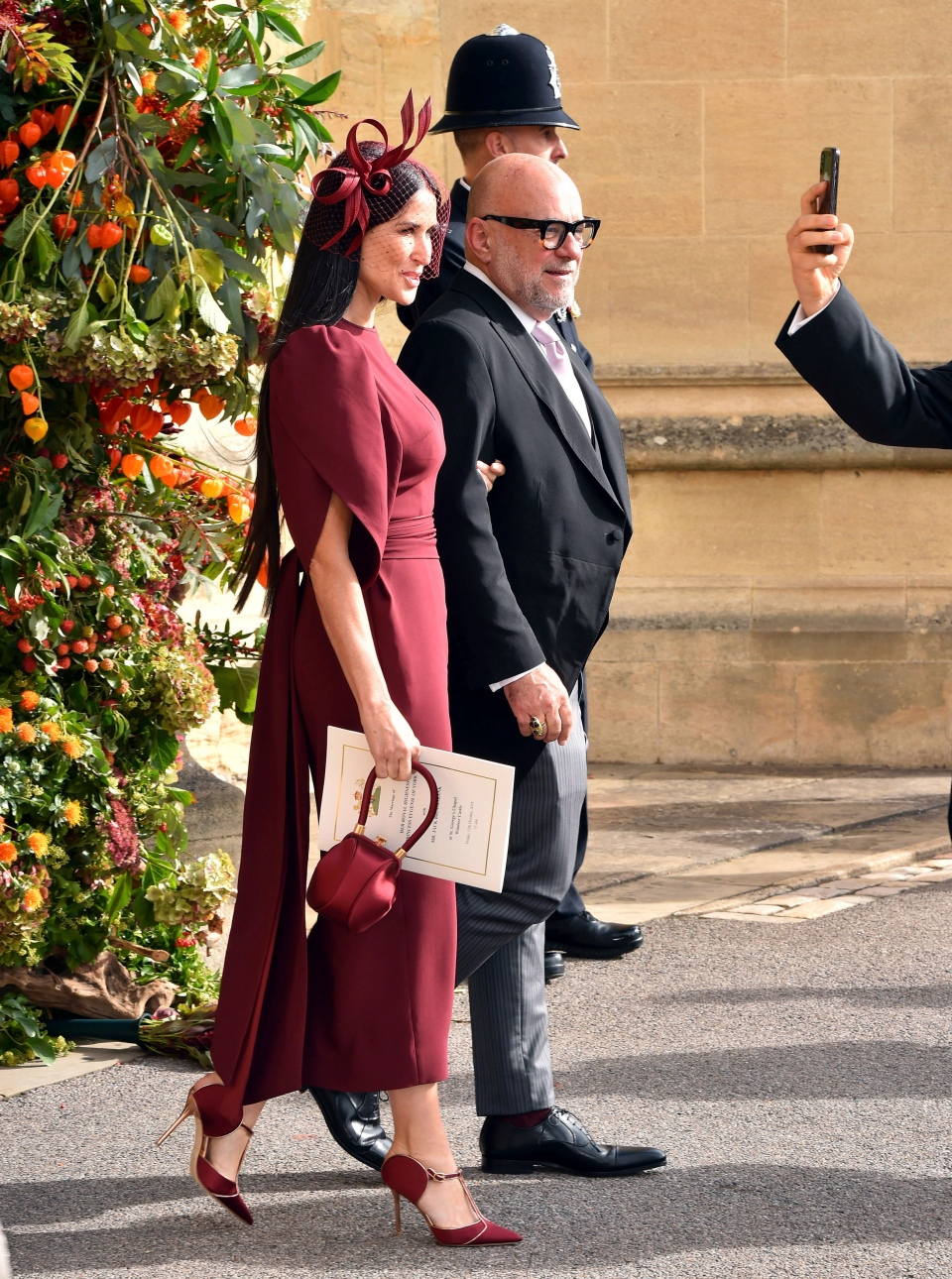 Actress Demi Moore, left, and Eric Buterbaugh depart after the wedding of Princess Eugenie of York and Jack Brooksbank at St George's Chapel, Windsor Castle, near London, England, Friday Oct. 12, 2018. (Matt Crossick, Pool via AP)