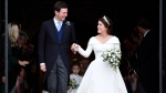 Princess Eugenie and Jack Brooksbank leave St George's Chapel after their wedding at Windsor Castle, near London, England, Friday Oct. 12, 2018. (Toby Melville, Pool via AP)
