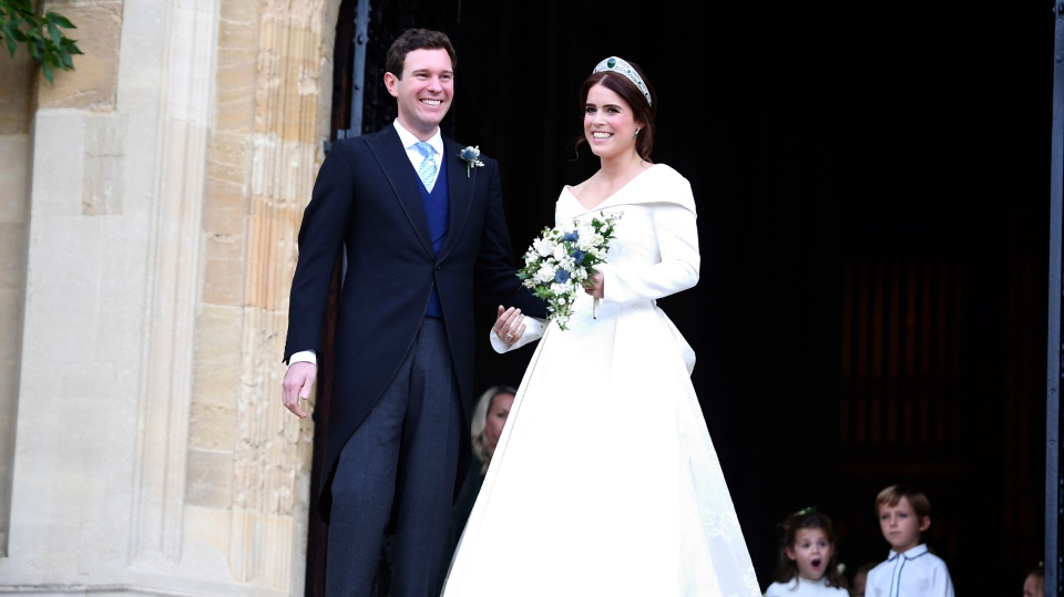 Princess Eugenie and her new husband Jack Brooksbank leave following their wedding at St George's Chapel, Windsor Castle, near London, England, Friday Oct. 12, 2018. (Victoria Jones/Pool via AP)