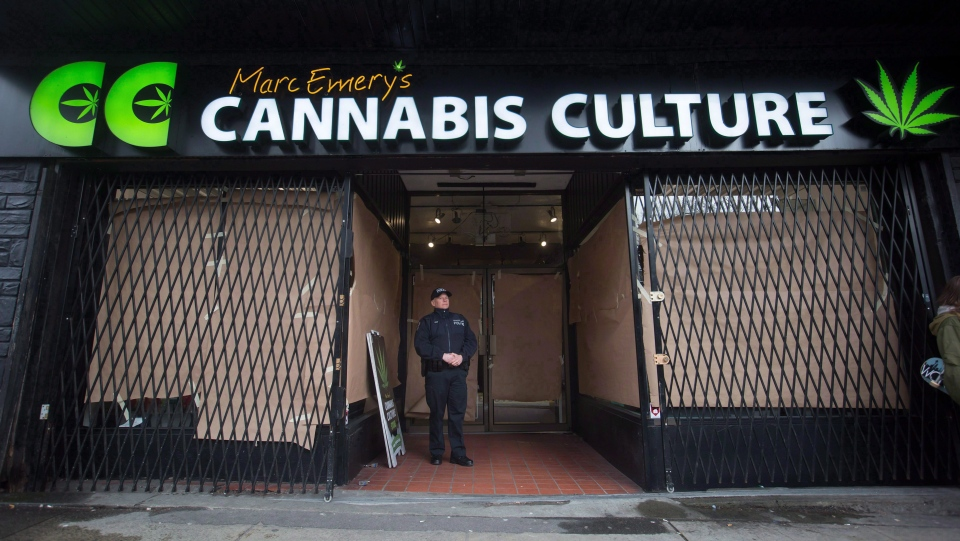 A police officer stands outside the Cannabis Culture shop during a police raid, in Vancouver, B.C., on Thursday March 9, 2017. THE CANADIAN PRESS/Darryl Dyck