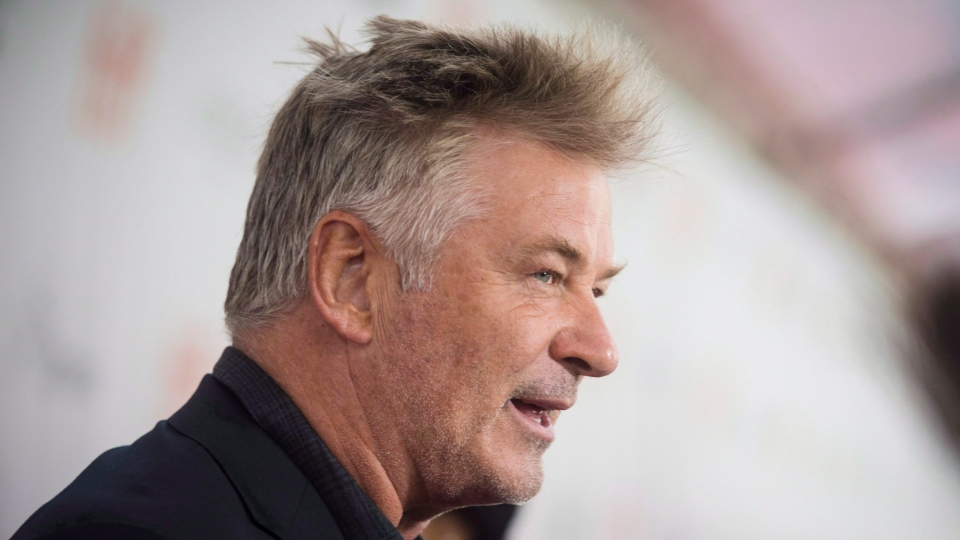 """Actor Alec Baldwin chats to reporters on the red carpet for the premiere of the film """"The Public"""" during the 2018 Toronto International Film Festival in Toronto on Sunday, September 9, 2018. (Tijana Martin/ The Canadian Press)"""