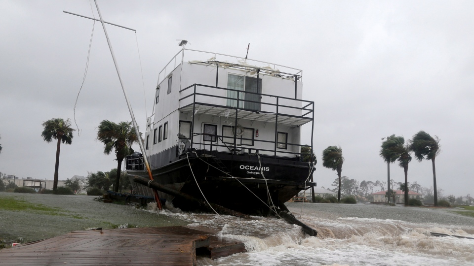 The Oceanis is grounded by a tidal surge at the Port St. Joe Marina, Wednesday, Oct. 10, 2018 in Port St. Joe, Fla. (Douglas R. Clifford/Tampa Bay Times via AP)