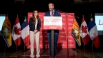 New Brunswick Liberal Leader Brian Gallant delivers a speech to supporters with his wife Karine Lavoie at his election-night headquarters in Grande-Digue, N.B. on Monday, September 24, 2018. THE CANADIAN PRESS/Darren Calabrese