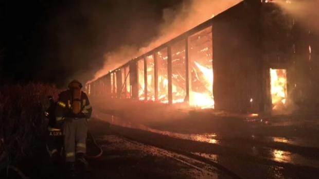 A hay barn on fire in Aylmer