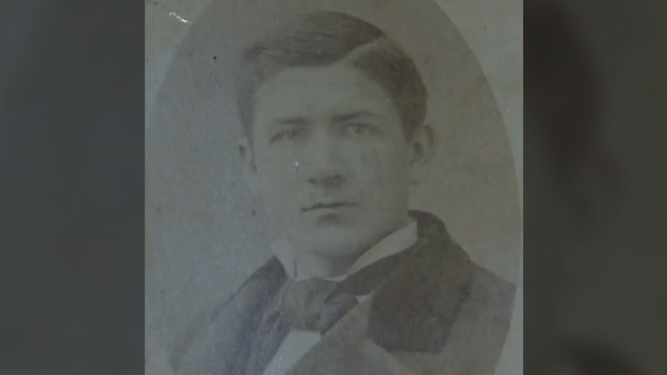 A photo of Wellington Herbert Jenkins found tucked behind an antique photo frame.