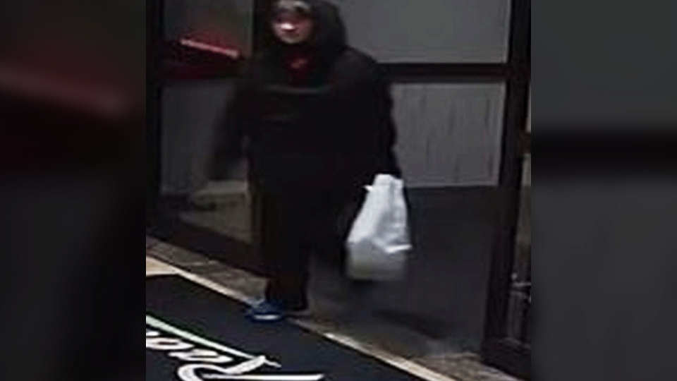 Toronto police are looking for a suspect, shown here, in an arson investigation after a fire was lit at a Toronto hotel on Tuesday, Oct. 2, 2018.