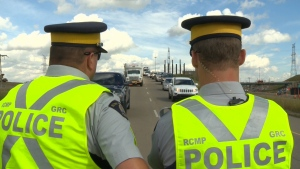 Two police officers examined a highway is seen in this file image.