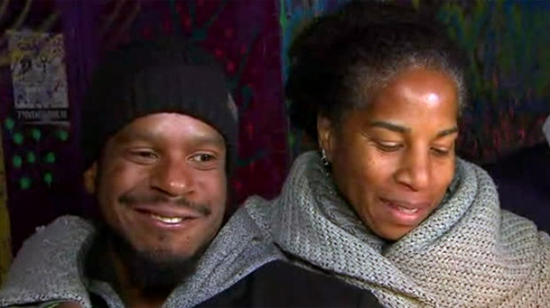 Andre Alexander's brother and mother are seen speaking at a vigil held on Friday night in Kensington Market.