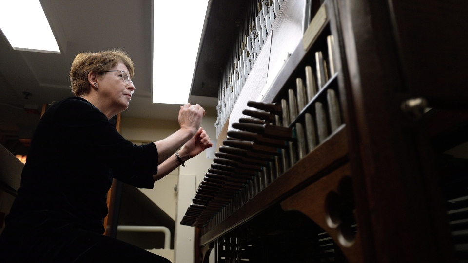 Dominion Carillonneur Dr. Andrea McCrady plays the Peace Tower Carillon on Parliament Hill in Ottawa on Friday, December 13, 2013. (THE CANADIAN PRESS / Sean Kilpatrick)