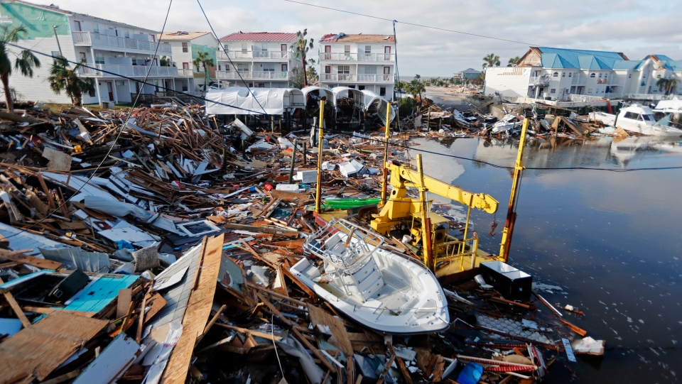 In this Oct. 11, 2018 file photo, a boat sits amidst debris in the aftermath of Hurricane Michael in Mexico Beach, Fla.  (AP Photo/Gerald Herbert, File)