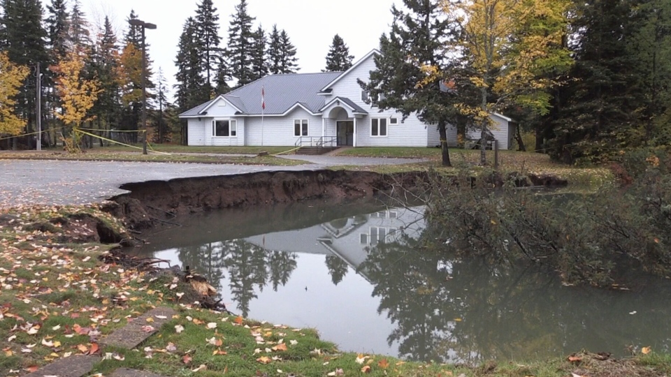 A sinkhole is seen outside the Lions Club in Oxford, N.S., on Friday, Oct. 12, 2018.