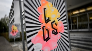 "Posters of an exhibition entitled ""LSD, the 75 Years of a Problem Child"" are seen at the entrance of the Swiss National Library. (Fabrice Coffrini / AFP)"