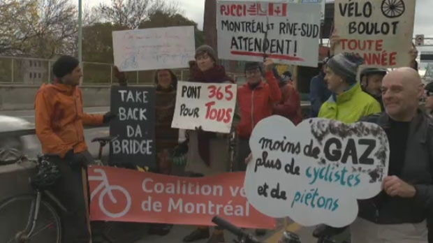 Cyclists protest the decision to close the Jacques Cartier Bridge's pike and pedestrian path during winter on Sat., Oct. 13, 2018.