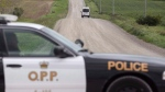 An Ontario Provincial Police van drives down a country road near Clinton, Ont., on Sunday, September 14, 2014. (THE CANADIAN PRESS/ Geoff Robins)