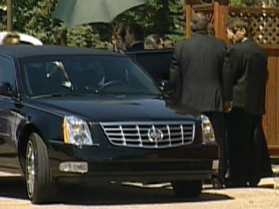 Mourners gather near Dave Batters' hearse on Saturday, July 4, 2009.