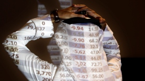 """In this Oct. 7, 2008, file photo, a Saudi trader reacts as looks at the stock market monitor in Riyadh, Saudi Arabia. The Saudi stock market sharply fell Sunday after President Donald Trump threatened """"severe punishment"""" over the disappearance of Washington Post contributor Jamal Khashoggi. (AP Photo/Hassan Ammar/File)"""
