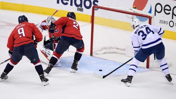 312fa57a881 Toronto Maple Leafs center Auston Matthews (34) prepares to score a goal  against Washington Capitals defenseman Dmitry Orlov (9)