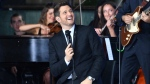 Michael Buble performs for a television program at Martin Place, Sydney, Australia, 04 October 2018. (EPA/MICK TSIKAS)