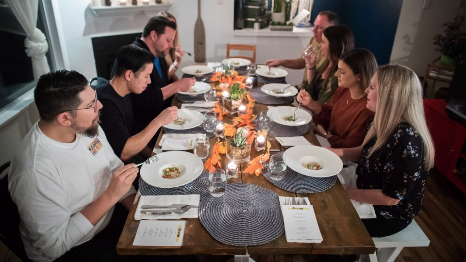 Guests dine on a geoduck crudo dish during a multi-course cannabis-infused meal hosted by chef Travis Petersen, in Vancouver, on Thursday October 11, 2018. (THE CANADIAN PRESS / Darryl Dyck)