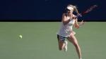 Eugenie Bouchard, of Canada, returns a shot to Marketa Vondrousova, of the Czech Republic, during the second round of the U.S. Open tennis tournament, Thursday, Aug. 30, 2018, in New York. (AP Photo/Seth Wenig)