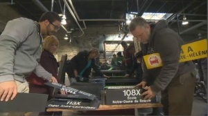 Transit lovers pick through signs at the STM's first-ever garage sale