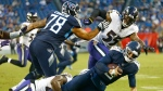 Tennessee Titans quarterback Marcus Mariota (8) is sacked by Baltimore Ravens linebacker Patrick Onwuasor for a 7-yard loss in the second half of an NFL football game Sunday, Oct. 14, 2018, in Nashville, Tenn. (AP Photo/Wade Payne)
