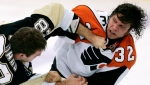 Pittsburgh Penguins' Eric Godard, left, and Philadelphia Flyers' Riley Cote fight in the first period of an NHL hockey game in Pittsburgh on Oct. 14, 2008. (AP Photo/Gene J. Puskar, File)