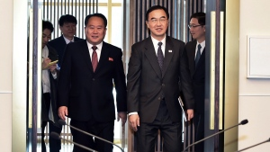 South Korean Unification Minister Cho Myoung-gyon, right, and his North Korean counterpart Ri Son Gwon arrive to hold their meeting at the southern side of Panmunjom in the Demilitarized Zone, South Korea, Monday, Oct. 15, 2018. (Korea Pool via AP)
