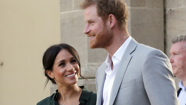 FILE - In this file photo dated Wednesday, Oct. 3, 2018, Britain's Prince Harry, right, and Meghan, Duchess of Sussex visit the Pavilion Building in Brighton, England. (AP Photo/Tim Ireland, FILE)