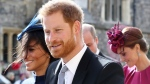 Prince Harry and Meghan Duchess of Sussex leave after the wedding of Princess Eugenie to Jack Brooksbank at St George's Chapel, Windsor Castle, near London, England, Friday Oct. 12, 2018. (Gareth Fuller/Pool via AP)
