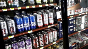This Wednesday, April 19, 2017 file photo shows the beer cooler behind the counter in a convenience store in Sheridan, Ind. (AP Photo/Michael Conroy)