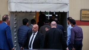 Members of the inspection team enter Saudi Arabia's Consulate in Istanbul, Monday, Oct. 15, 2018. (AP / Petros Giannakouris)
