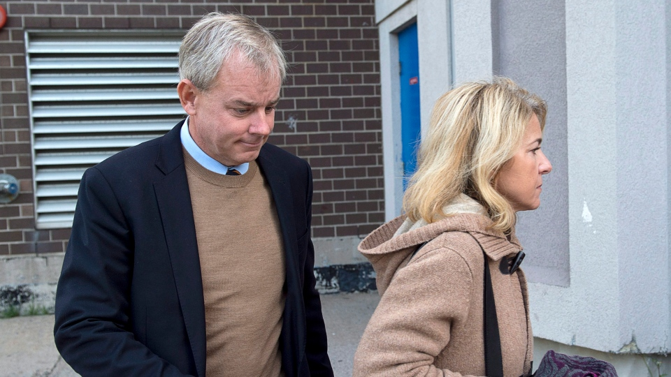 Dennis Oland and his wife Lisa arrive at Harbour Station arena in Saint John, N.B., on Monday, Oct. 15, 2018 for jury selection in the retrial in the bludgeoning death of his millionaire father, Richard Oland.  (THE CANADIAN PRESS/Andrew Vaughan)
