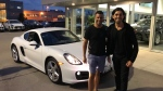 Karan Walia (right) bought a 2015 Porsche Cayman for his friend Zamir Rahemtulla, who helped him out when Walia was starting up a business that later sold for $53 million. (Karan Walia)