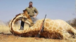 Blake Fischer, a member of the Idaho Fish and Game Commission, has been criticized over photos he shared of himself posing with animals he killed while hunting in Africa, including a giraffe. (WKRC-TV / CNN)