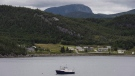A fishing boat is moored in Neddy Harbour in Gros Morne National Park, Newfoundland and Labrador, on Monday, August 15, 2016. THE CANADIAN PRESS/Darren Calabrese