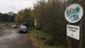 Police cruisers on-scene after a deceased male was reported on a Kitchener walking trail.