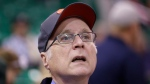 In this Oct. 12, 2015 file photo, Portland Trail Blazers owner Paul Allen looks on before the start of the first quarter of an NBA preseason basketball game against the Utah Jazz in Salt Lake City. (AP Photo/Rick Bowmer, File)