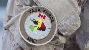 The UN Mali patch is shown on a Canadian forces member's uniform before boarding a plane at CFB Trenton in Trenton, Ont., on July 5, 2018. THE CANADIAN PRESS/Lars Hagberg