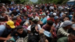 Hundreds of Hondurans are blocked at the border crossing in Agua Caliente, Guatemala, Monday, Oct. 15, 2018. (AP Photo/Moises Castillo)