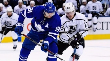Toronto Maple Leafs centre John Tavares (91) protects the puck from Los Angeles Kings right wing Tyler Toffoli (73) during first period NHL hockey action in Toronto on Monday, October 15, 2018. THE CANADIAN PRESS/Nathan Denette