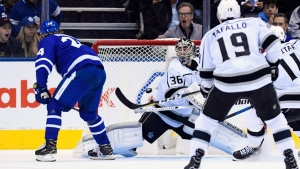 Toronto Maple Leafs right wing Kasperi Kapanen (24) scores on Los Angeles Kings goaltender Jack Campbell (36) during third period NHL hockey action in Toronto on Monday, October 15, 2018. (THE CANADIAN PRESS/Nathan Denette)
