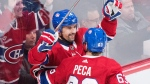 Montreal Canadiens' Tomas Plekanec (14) celebrates with teammate Matthew Peca after scoring against the Detroit Red Wings during first period NHL hockey action in Montreal, Monday, October 15, 2018. (THE CANADIAN PRESS/Graham Hughes)