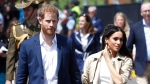 Prince Harry and Meghan, Duchess of Sussex arrive at the Opera House in Sydney, Australia, Tuesday, Oct. 16, 2018. Prince Harry and his wife Meghan are on a 16-day tour of Australia and the South Pacific.(Chris Jackson/Pool via AP)