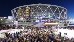 FILE - In this June 8, 2018, file photo, Golden State Warriors fans celebrate outside Oracle Arena in Oakland, Calif., after the Warriors won the NBA basketball championship. The Warriors are playing their final season at the arena and will be moving to Chase Center in San Francisco in 2019. (AP Photo/Josh Edelson, File)